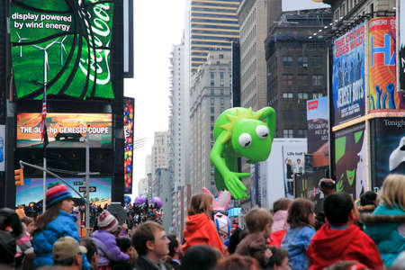 MANHATTAN - NOVEMBER 26 : Kermit the Frog balloon passing Times Square at the Macy's Thanksgiving Day Parade November 26, 2009 in Manhattan. Stock Photo - 7374295