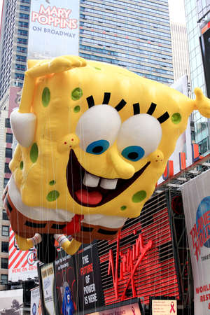 MANHATTAN - NOVEMBER 26 : A Sponge Bob balloon passing Times Square at the Macy's Thanksgiving Day Parade November 26, 2009 in Manhattan. Stock Photo - 7374309