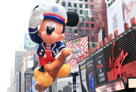 MANHATTAN - NOVEMBER 26 : A Sailor Mickey Mouse balloon passing Times Square at the Macy's Thanksgiving Day Parade November 26, 2009 in Manhattan.
