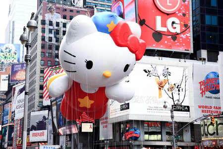 MANHATTAN - NOVEMBER 26: A Hello Kitty balloon passing Times Square at the Macy's Thanksgiving Day Parade November 26, 2009 in Manhattan. Stock Photo - 7374315