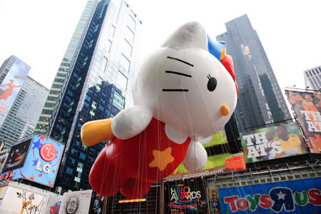 MANHATTAN - NOVEMBER 26 : A hello kitty balloon passing Times Square at the Macy's Thanksgiving Day Parade November 26, 2009 in Manhattan. Stock Photo - 7374316