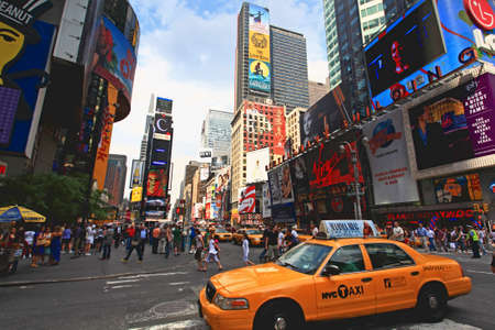 show time: The famous Times Square at Mid-town Manhattan - a wide angle view