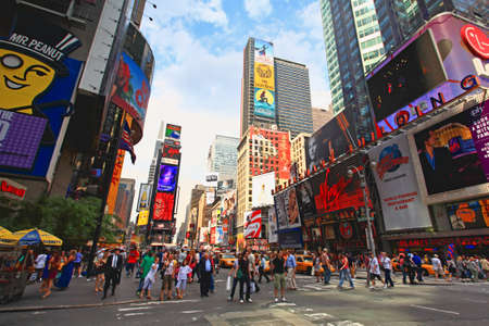 The famous Times Square at Mid-town Manhattan - a wide angle view Reklamní fotografie - 7374413
