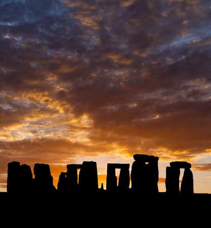 The silhouette of Stonehenge in UK under sunrise background photo