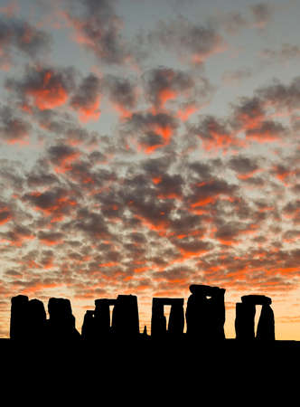 The silhouette of Stonehenge in UK under sunrise background