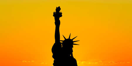 The silhouette of Statue of Liberty under sunrise background Stock Photo - 7560478