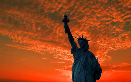 lady justice: The silhouette of Statue of Liberty under sunrise background
