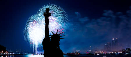 The silhouette of Statue of Liberty Statue of Liberty and July 4th fireworks over Hudson River photo