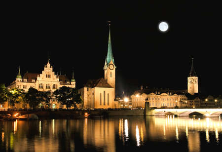 grossmunster cathedral: The night view of major landmarks in Zurich Switzerland Stock Photo
