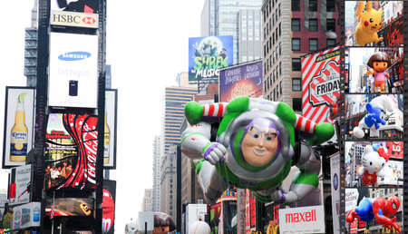 MANHATTAN - NOVEMBER 26: A Buzz Lightyear balloon passing Times Square at the Macy's Thanksgiving Day Parade November 26, 2009 in Manhattan. Stock Photo - 8076120