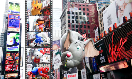 macys: MANHATTAN - NOVEMBER 26 : A Dumbo the Elephant balloon passing Times Square at the Macys Thanksgiving Day Parade November 26, 2009 in Manhattan.
