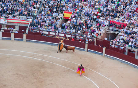 Madrid - OCTOBER 1: The huge crowd jammed in the famous Plaza de Toros are watching the bullfight on OCTOBER 1, 2010 in Madrid. Spain.