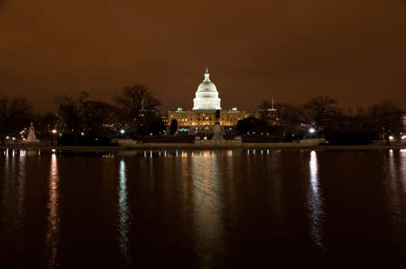 United States Capitol Building at night in Washington DC photo