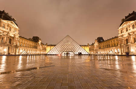 PARIS - DECEMBER 7: The Louvre Museum at the rainy night on December 7, 2010 in Paris France