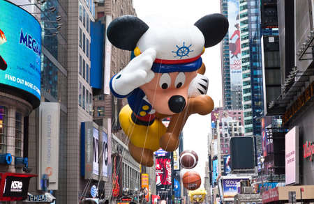 MANHATTAN - NOVEMBER 25 : Mickey Mouse character balloon passing Times Square at the Macys Thanksgiving Day Parade November 25, 2010 in Manhattan.