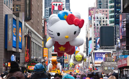 macys: MANHATTAN - NOVEMBER 25 : Hello Kitty character balloon passing Times Square at the Macys Thanksgiving Day Parade November 25, 2010 in Manhattan. Editorial