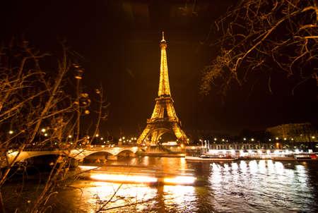 illuminated: PARIS, FRANCE - DECEMBER 2: Ceremonial lighting of the Eiffel tower on  DECEMBER 2, 2010 in Paris, France. The Eiffel tower is the most visited monument of France. Editorial