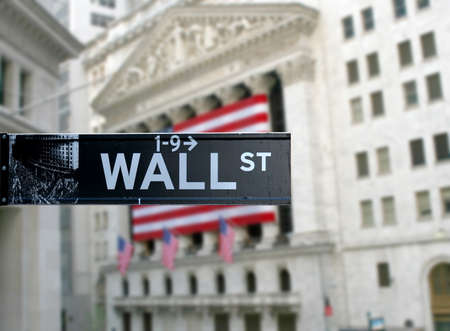 main market: Wall street sign with New York Stock Exchange background