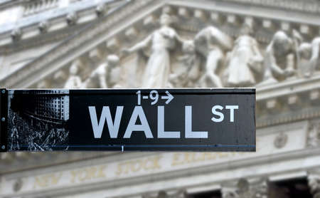 Wall street sign with New York Stock Exchange background  Stock Photo - 9255603
