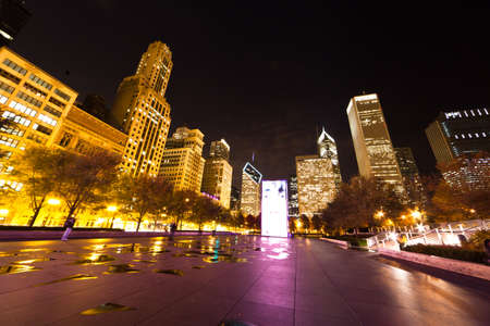 Millennium Plaza in Downtown, Chicago. The amazing night view of the light and reflection of Chicago Skyline photo