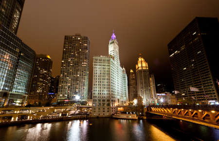 The high-rise buildings along Chicago River at Night photo
