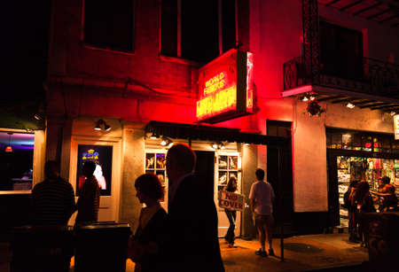 NEW ORLEANS, USA - APRIL 2: The Bourbon Streets in the French Quarter with crazy nightlife scene, and lined with bars and clubs, where is crowded with tourists and locals on Saturday night April 2, 2011.
