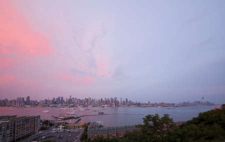 boat party: The panoramic view of the complete Manhattan Island at sunset from New Jersey side