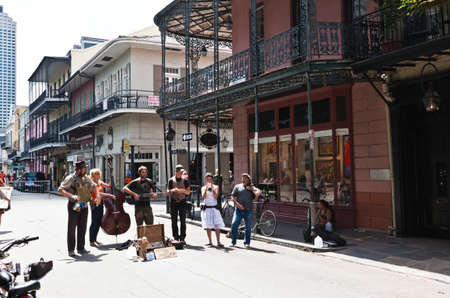 NEW ORLEANS, LOUISIANA - APRIL 3: A jazz band plays in Jackson Square April  3,2011 in New Orleans, where tourists and locals enjoyed on a sunny weekend in Spring. Editorial
