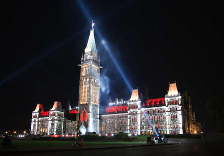 OTTAWA, CANADA – AUGEST 22:  The beautiful light show projected on the parliament building to celebrate the Canada's rich history and friendly people in the summer night of August 22, 2011 in Ottawa, Canada. Stock Photo - 18330183
