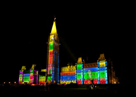 OTTAWA, CANADA. AUGUST 22:  The beautiful light show projected on the parliament building to celebrate the Canada rich history and friendly people in the summer night of August 22, 2011 in Ottawa, Canada