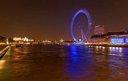 london eye: The London eye and the River Thames by night, London