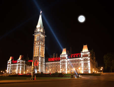 The beautiful illumination of the Canadian House of Parliament at night photo