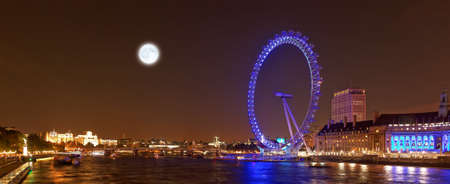 The London eye and the River Thames by night, London