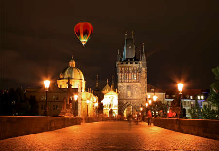 The night view of the beautiful Prague City along the River Vltava photo
