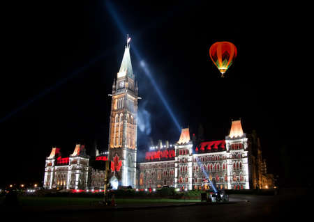 OTTAWA, CANADA – AUGEST 22   The beautiful light show projected on the parliament building to celebrate the Canada's rich history and friendly people in the summer night of August 22, 2011 in Ottawa, Canada