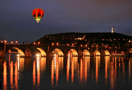 The night view of the Charles Bridge in Prague City photo