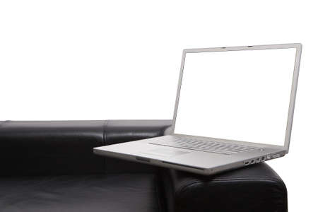 Laptop on modern couch isolated background and screen with clipping paths so you can insert your own items photo