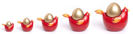 Growth concept represented by golden eggs in a graph format Stock Photo - 4139543