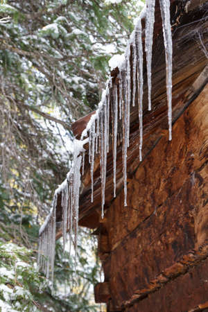 Ice Dripping From a Cabin Roof - Colorado Rocky Mountain Scenic Beauty