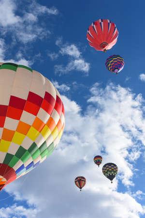 Hot Air Balloons lifting off at the Snowdown balloon festivle in Durango, Colorado