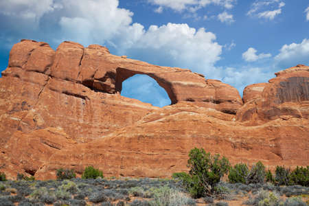 Travel and Tourism scenes from the Western United States. Red Rock Formations And Dramatic Landscapes Skyline Arch. Arches National Park Utah. Stok Fotoğraf