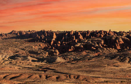 Dramatic Red Rock Formations at sunrise in Arches National Park near Moab, Utah.