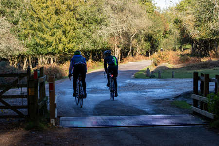 06/18/2019 Lymington, Hampshire, UK A pair of cyclists riding side by side on country roads