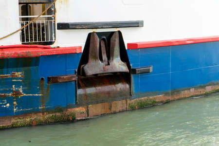 a ships anchor on the side of a ship
