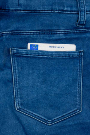 A UK Driving licence or license in the back pocket of a pair of jeans