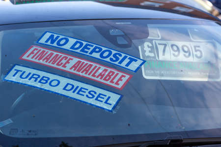 the price stickers on the inside of a car that is for sale in a car showroom