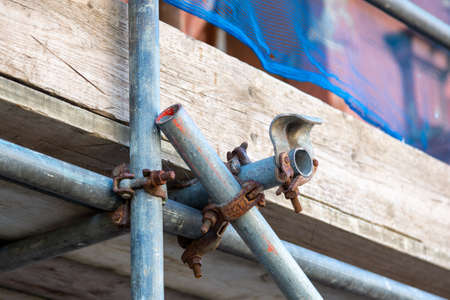 a close up of scaffolding poles on a building site using selective focus