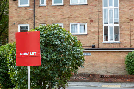 A now Let sign in front of a block of flats in the background