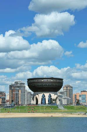 dashi: Kazan, Tatarstan, Russia - July 6, 2016. Kazan Central Wedding Palace. Sculptor Dashi Namdakov. View of the right bank of the river Kazanka.