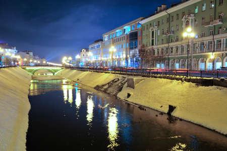 Kazan, Tatarstan, Russia - December 7, 2017. Street Pravo-Bulachnaya, Levobulachnaya street, Bulak river, bridge Tears. Night winter city landscape.
